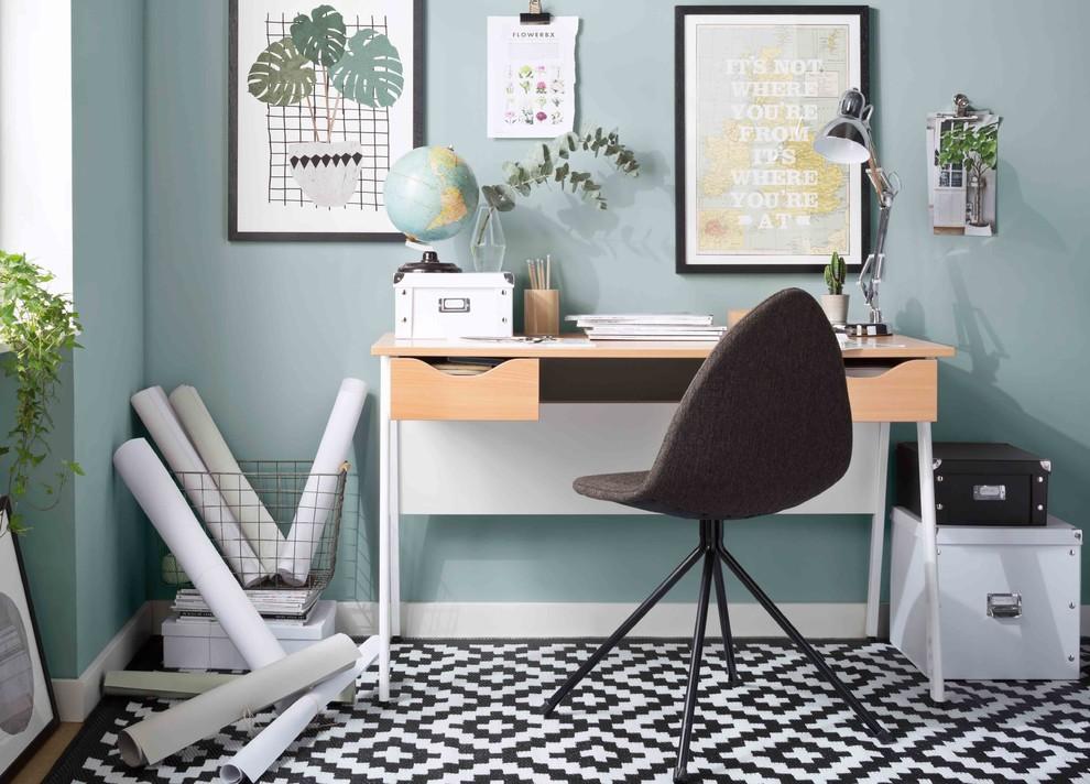 Home office - small scandinavian freestanding desk multicolored floor home office idea in Berlin with blue walls