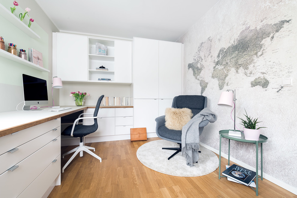 Inspiration for a mid-sized scandinavian built-in desk light wood floor and beige floor study room remodel in Berlin with beige walls and no fireplace