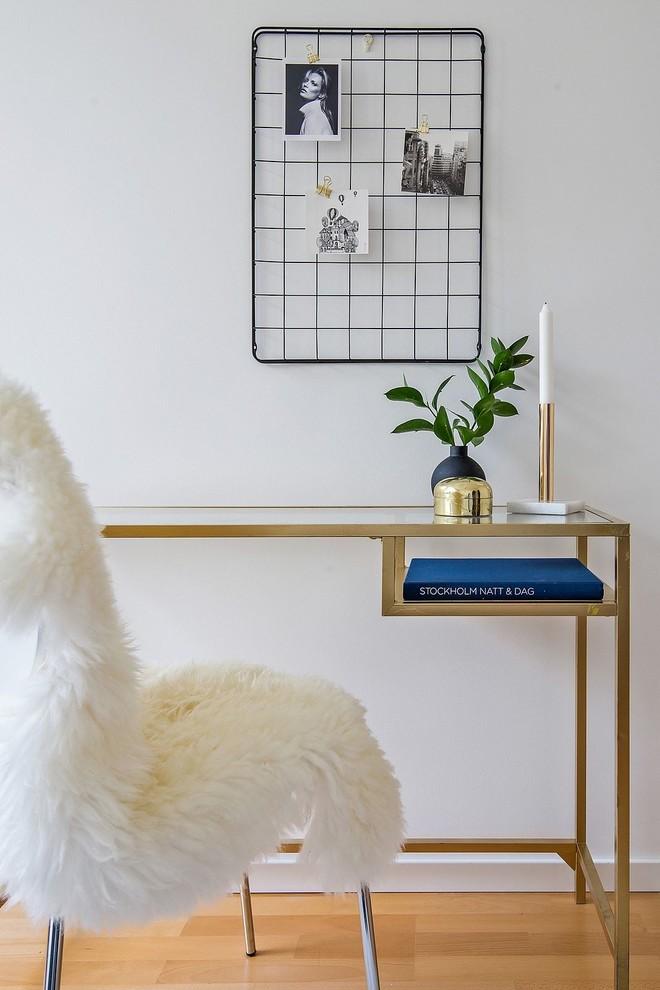 Study room - scandinavian freestanding desk medium tone wood floor study room idea in Stockholm with white walls