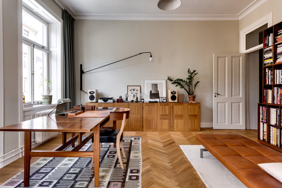 Study room - large scandinavian freestanding desk light wood floor study room idea in Stockholm with gray walls and no fireplace