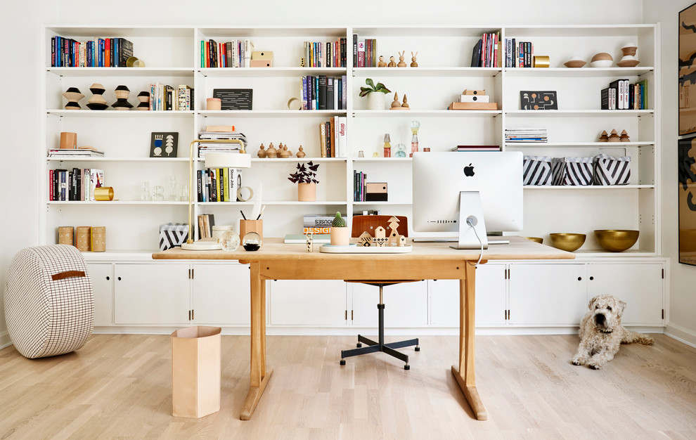 Inspiration for a mid-sized scandinavian freestanding desk light wood floor study room remodel in Gothenburg with white walls and no fireplace