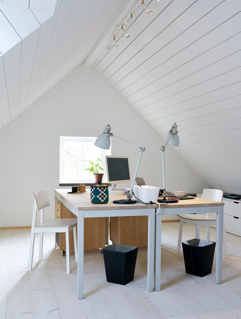 Study room - mid-sized transitional freestanding desk light wood floor study room idea in Stockholm with white walls and no fireplace