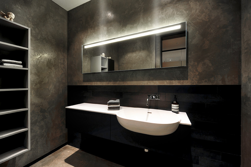 Inspiration for a medium sized contemporary bathroom in Other with flat-panel cabinets, black cabinets, brown walls and a built-in sink.
