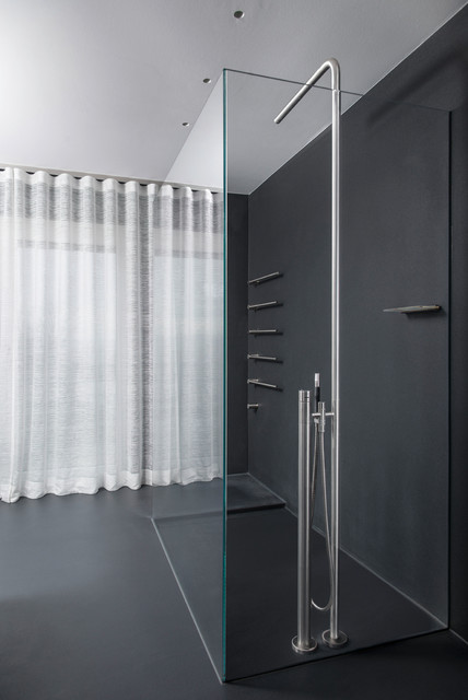 Example of a large trendy walk-in shower design in Stuttgart with black walls