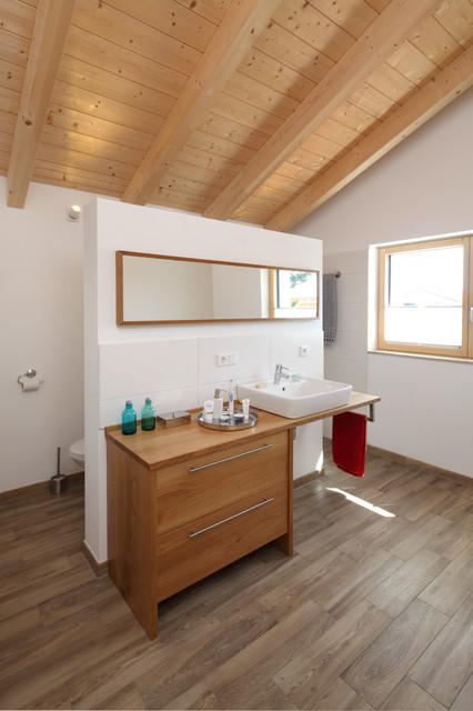 Holzbau Gruber kienberg i farmhouse bathroom munich by holzbau gruber
