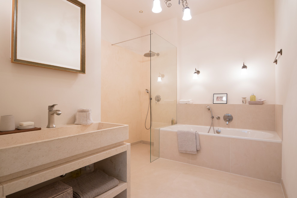 Example of a large classic beige tile beige floor bathroom design in Berlin with open cabinets, white walls and a wall-mount toilet