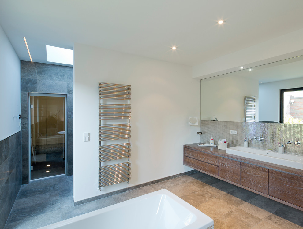 Trendy master metal tile bathroom photo in Dusseldorf with a trough sink, flat-panel cabinets, medium tone wood cabinets, wood countertops and white walls