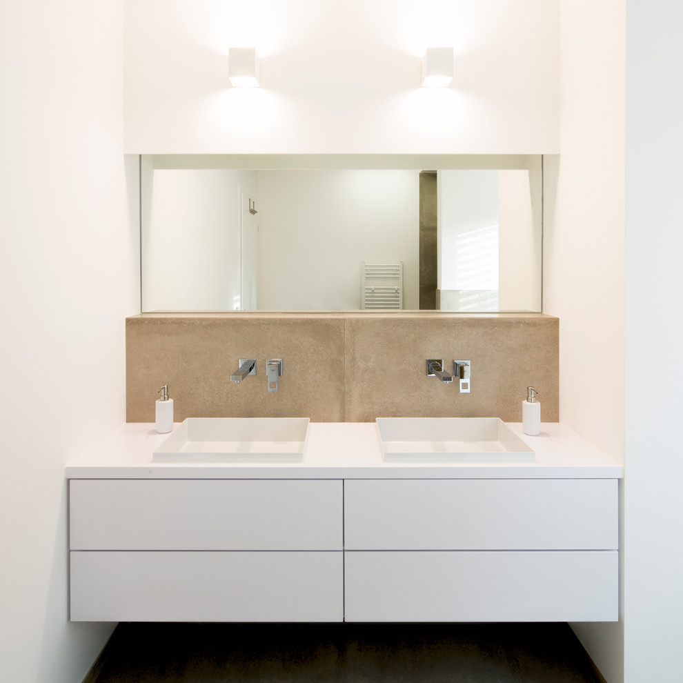 Trendy brown tile and stone slab bathroom photo in Dusseldorf with a drop-in sink