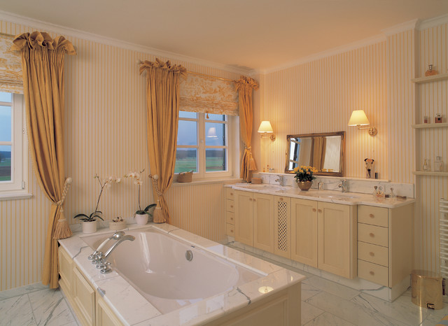 Bathroom - large cottage white tile and stone slab marble floor bathroom idea in Other with shaker cabinets, light wood cabinets, an undermount tub, multicolored walls, an undermount sink and marble countertops