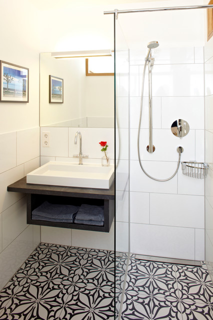 Small elegant 3/4 white tile and ceramic tile ceramic floor and multicolored floor corner shower photo in Munich with a vessel sink, white walls, open cabinets, black cabinets and engineered quartz countertops