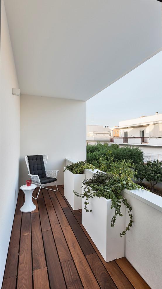 Balcony - small contemporary balcony idea in Bari with a roof extension