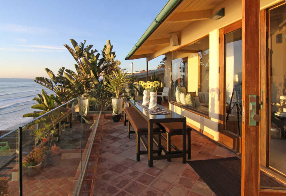 Island style balcony photo in San Diego with no cover
