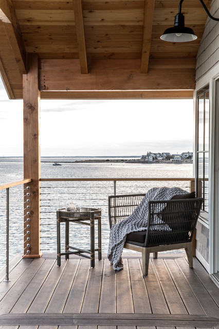 Small coastal balcony photo in Portland Maine with a roof extension