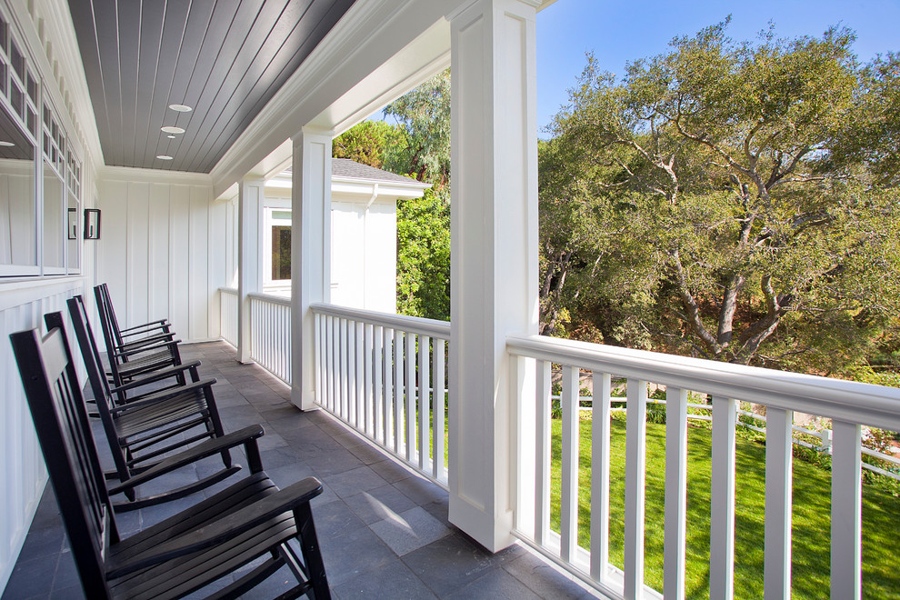 Example of a classic balcony design in Los Angeles with a roof extension