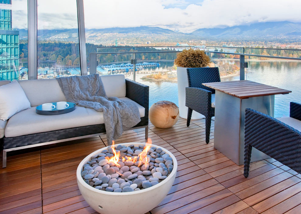 Balcony - contemporary balcony idea in Vancouver with a fire pit