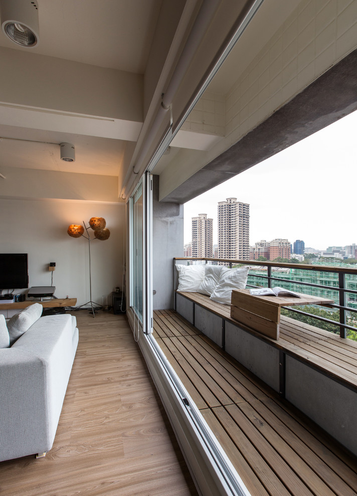Balcony - contemporary balcony idea in Other with a roof extension