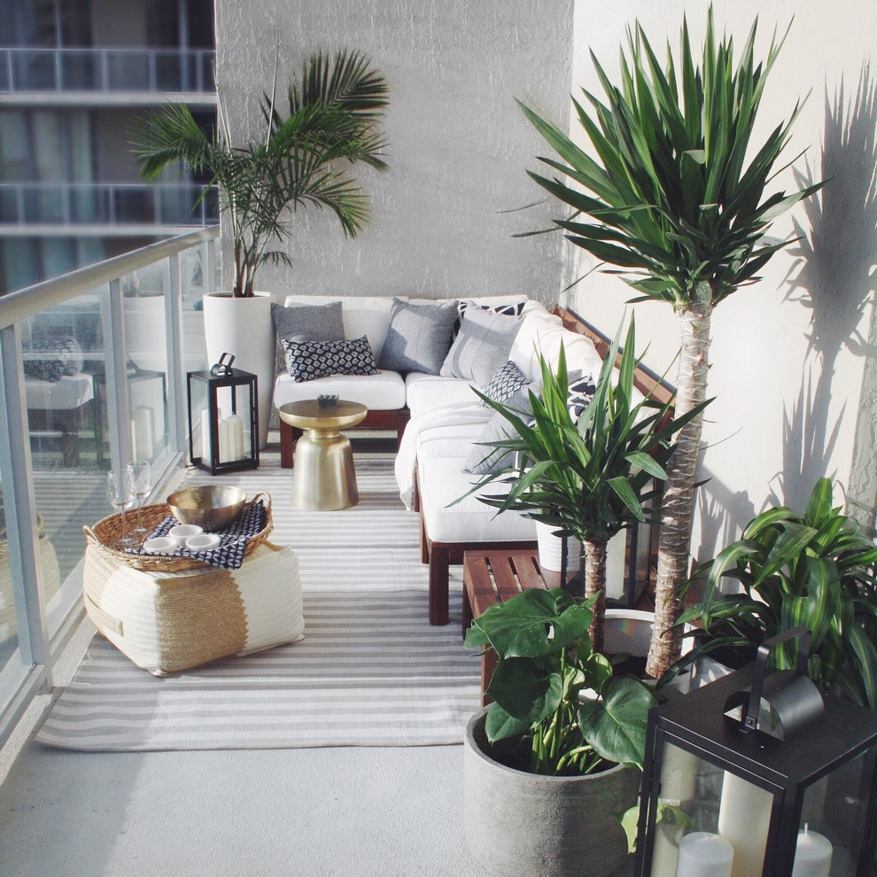 Inspiration for a small balcony remodel in Miami with a roof extension