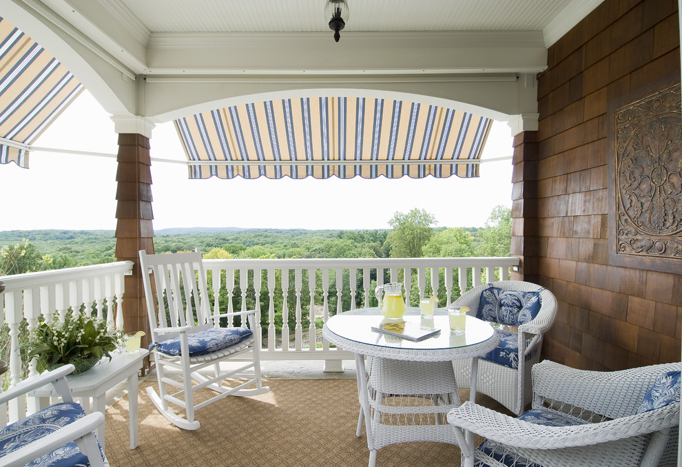 Example of a classic balcony design in Bridgeport with a roof extension