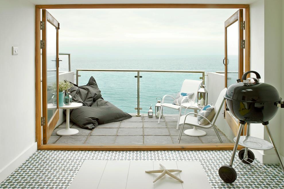 Balcony - small coastal balcony idea in London with no cover