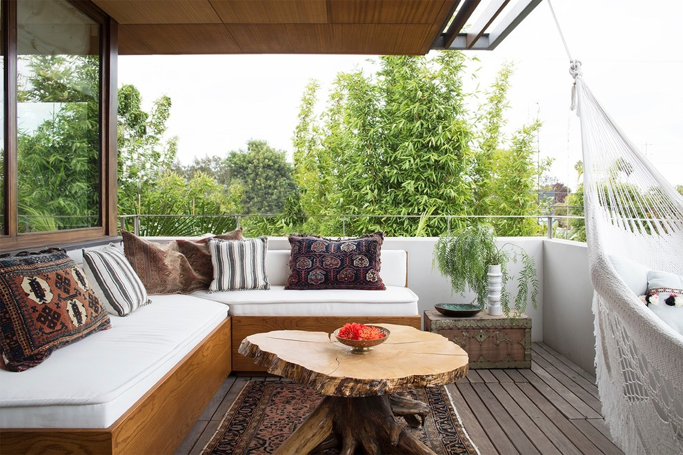 Mid-sized trendy balcony photo in Los Angeles with a roof extension