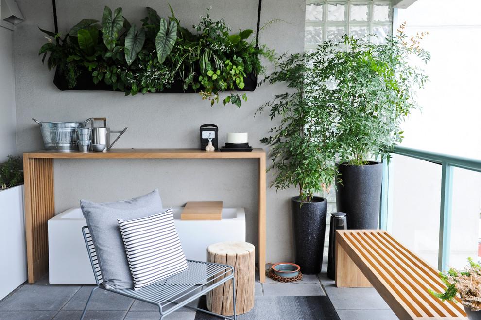 Balcony - contemporary balcony idea in Vancouver