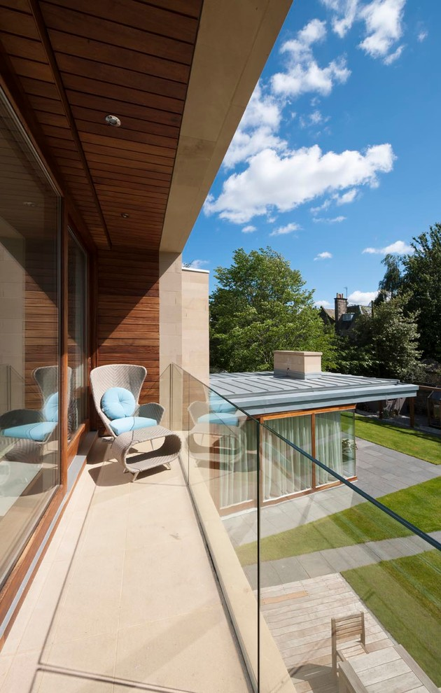 Inspiration for a large contemporary balcony remodel in Edinburgh with a roof extension