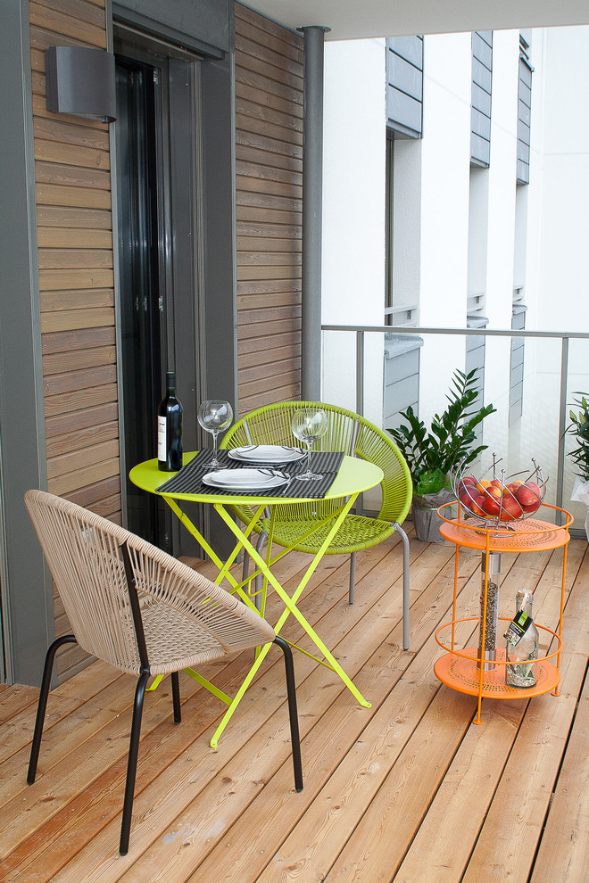 Balcony - small contemporary balcony idea in Lyon with a roof extension