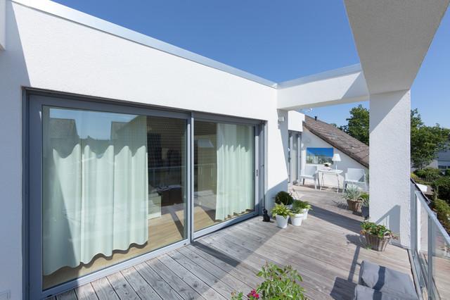 wohnhauserweiterung 2 wohneinheit mit kleinem l dchen modern terrasse other metro von. Black Bedroom Furniture Sets. Home Design Ideas