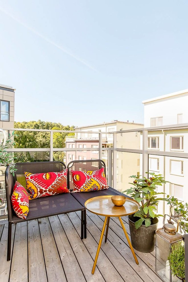 Small trendy balcony container garden photo in Stockholm with no cover