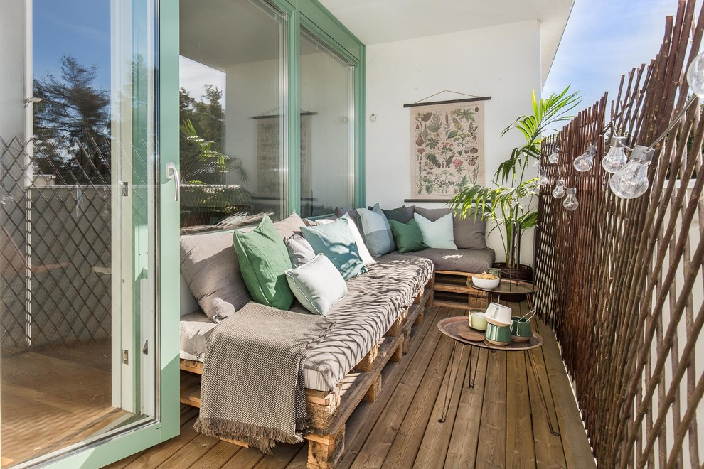 Danish wood railing balcony photo in Stockholm with a roof extension
