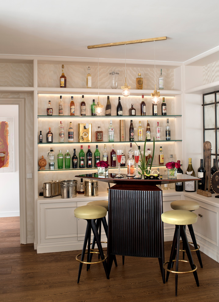 Inspiration for a small transitional single-wall dark wood floor and brown floor seated home bar remodel in Barcelona with open cabinets, white cabinets and wood countertops