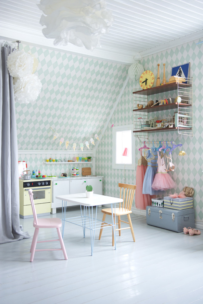 Example of a large danish girl painted wood floor kids' room design in Other with multicolored walls