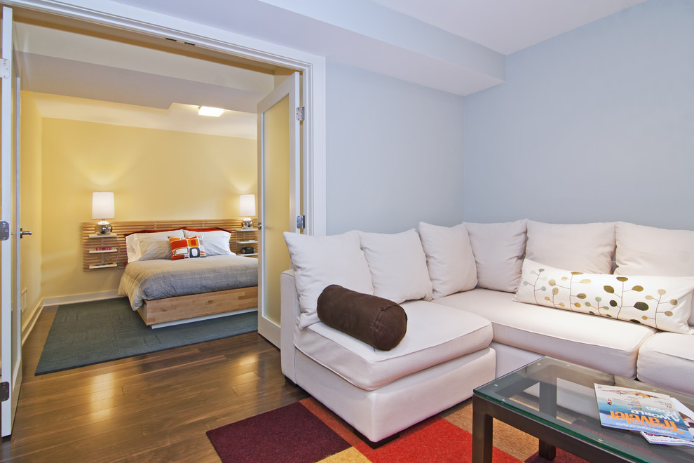 Example of a minimalist basement design in Minneapolis with blue walls