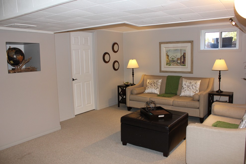 Mid-sized transitional look-out carpeted and beige floor basement photo in Toronto with beige walls and no fireplace