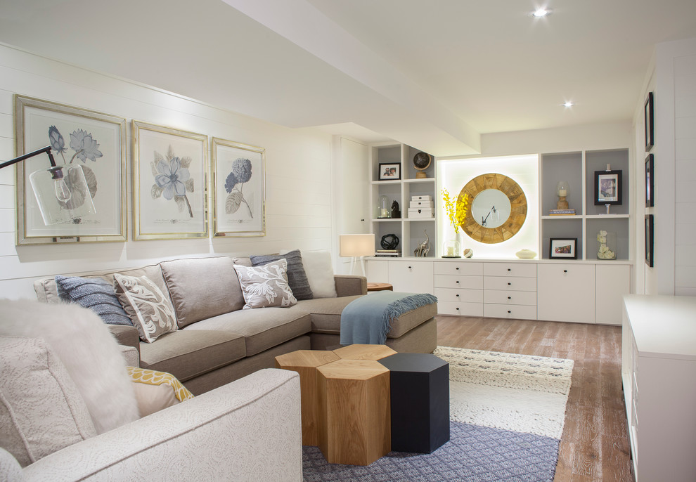 Basement - mid-sized transitional medium tone wood floor and brown floor basement idea in Toronto with white walls