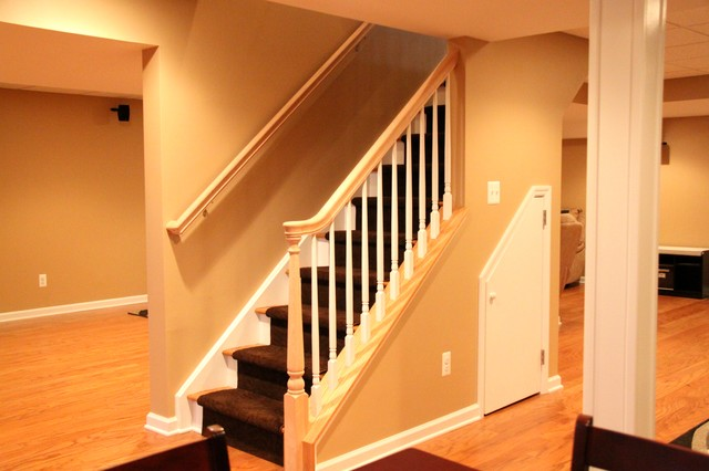 open basement stairs. An open concept traditional basement  Traditional Basement New York by Joseph