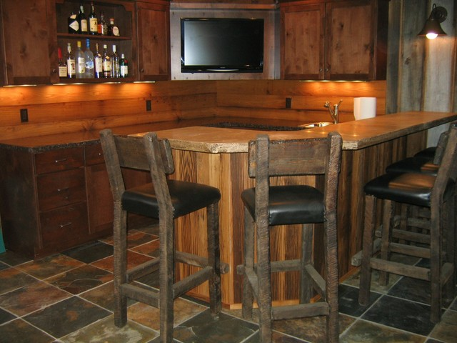 Bar styed as pub rustic basement cleveland by studio 76 kitchens and baths - Rustic basement bar designs ...