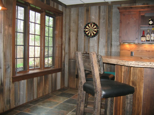 Bar styed as pub rustic basement cleveland by for Rustic finished basement