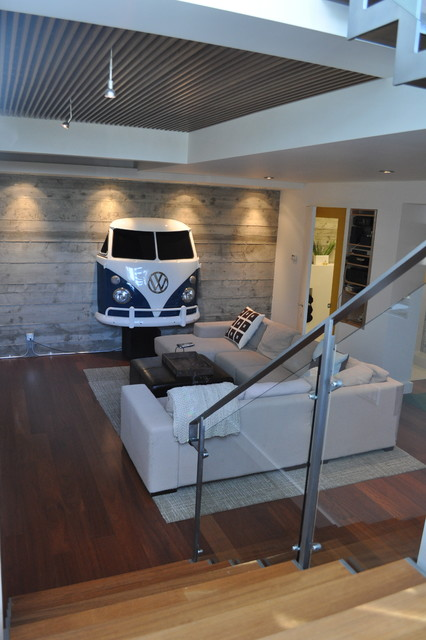 Basement addition - exposed concrete walls, wood grille ceiling