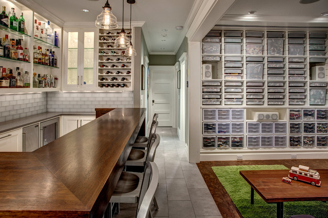 Basement - transitional underground basement idea in Seattle with gray walls and no fireplace