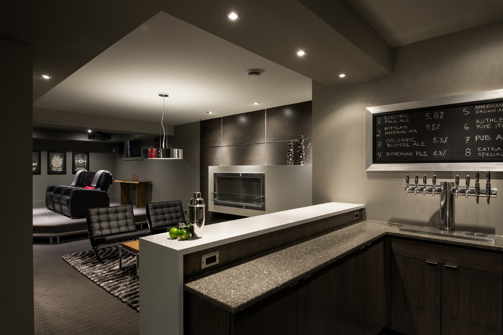 Example of a trendy underground carpeted and gray floor basement design in Toronto with gray walls and a ribbon fireplace