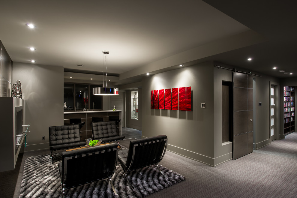 Example of a trendy underground carpeted and gray floor basement design in Toronto with gray walls