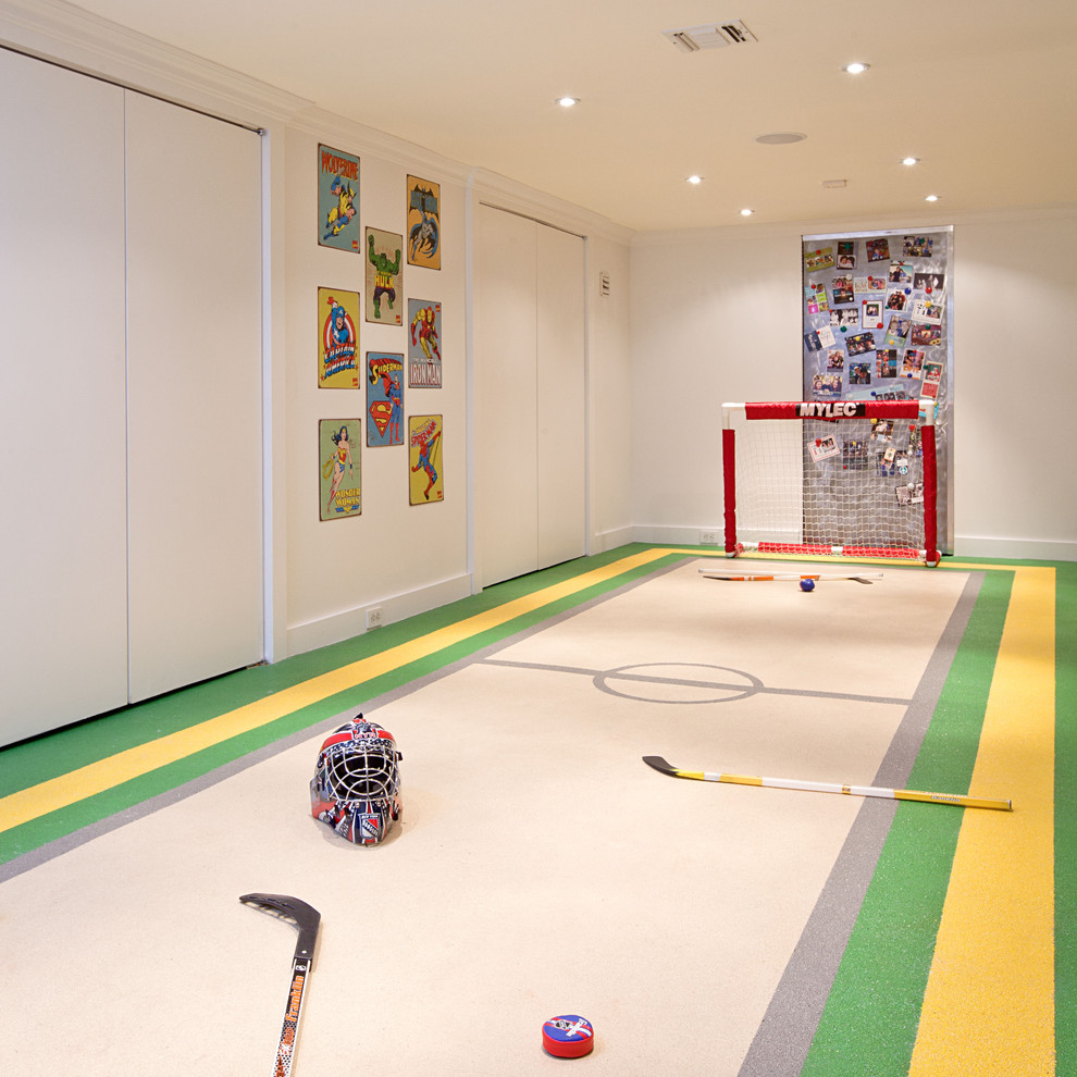 Example of a trendy underground basement design in New York with white walls and no fireplace