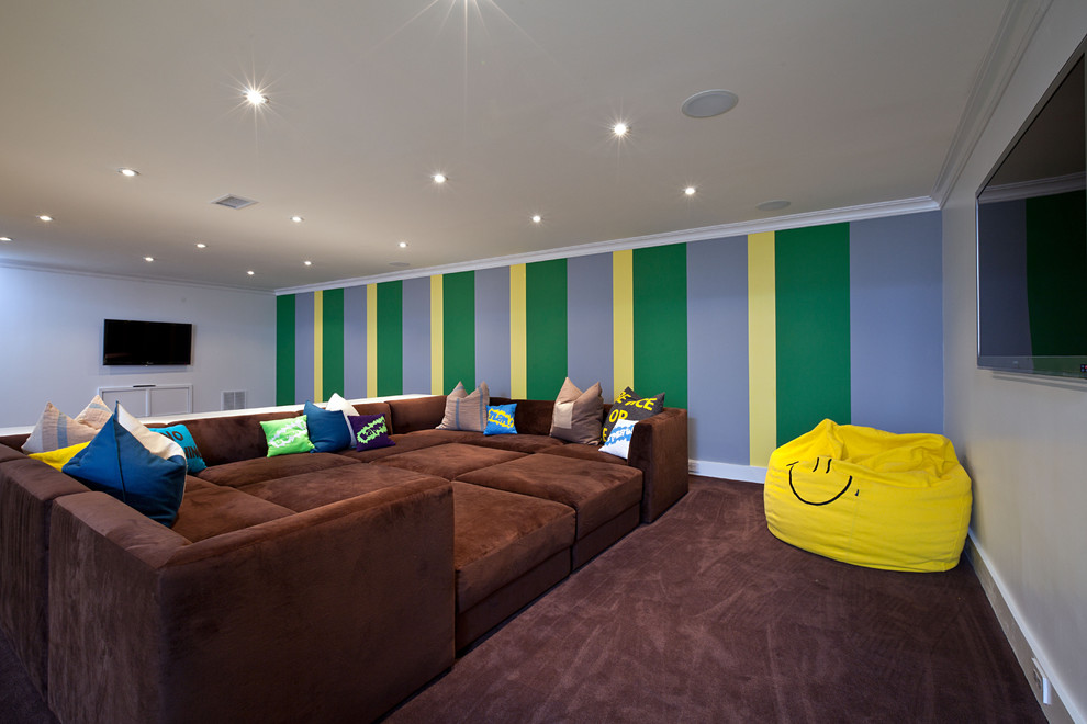 Trendy carpeted basement photo in New York with multicolored walls