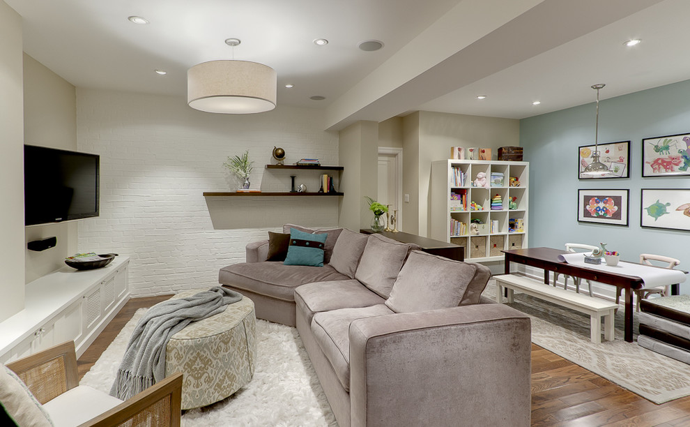 Example of a classic underground medium tone wood floor basement design in Toronto with blue walls and no fireplace