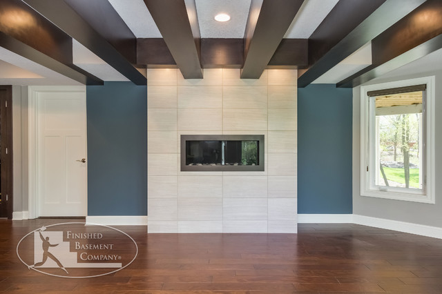basement fireplace and wood beam ceiling contemporary