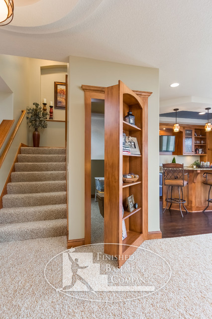 Basement hidden bookshelf storage traditional basement minneapolis by finished basement - Finished basement storage ideas ...