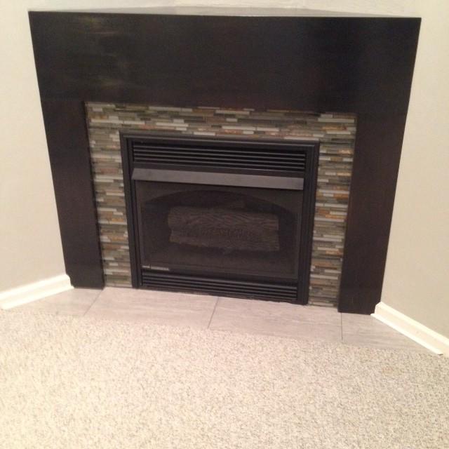 Basement Kitchenette and Corner Fireplace