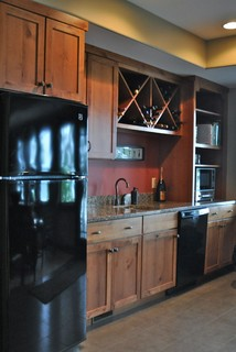 Basement Kitchenette Fireplace Cabinetry And Guest