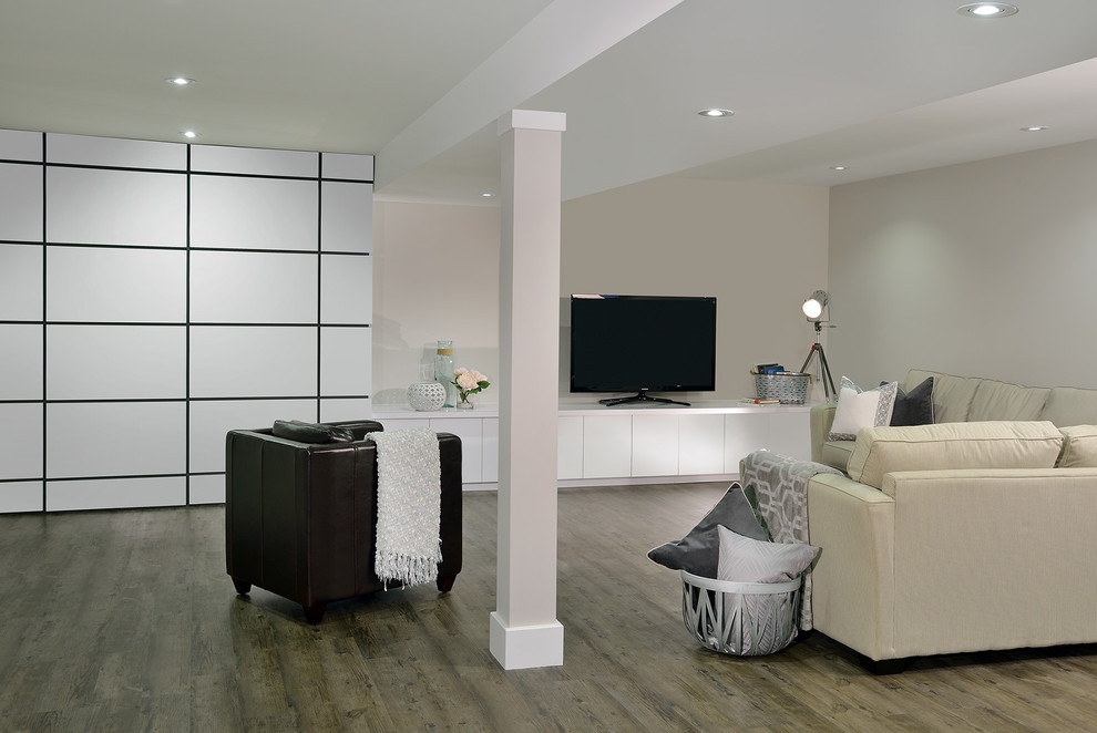 Example of a large minimalist underground basement design in Toronto with gray walls